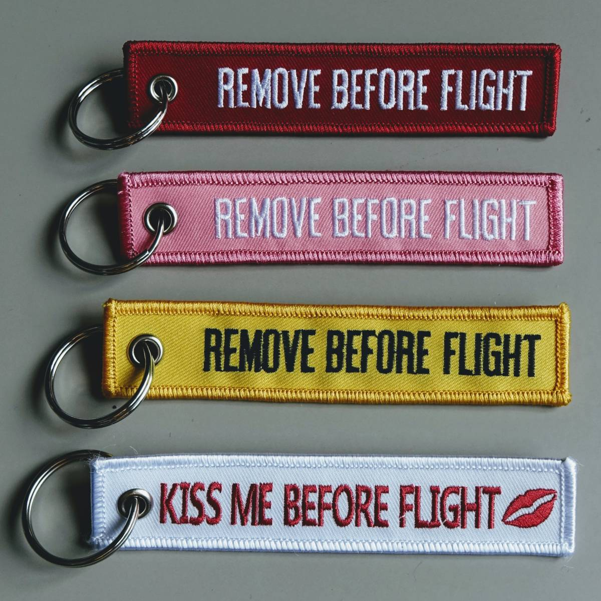 REMOVE BEFORE FLIGHT embroidered key chains